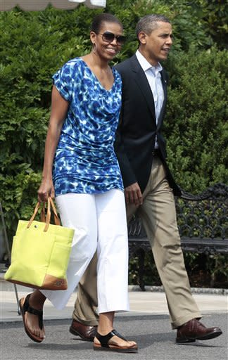 """""""If there's any consolation for Mr. Obama, it's that gray equals gravitas, and a president can never have too much of that."""" – David Axelrod tells CBS Evening News correspondent Chip Reid in March 2009. The president and first lady Michelle Obama prepare to board Marine One on June 10, 2011. (AP Photo/Pablo Martinez Monsivais)"""