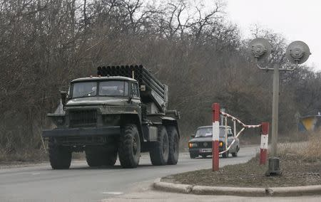 A Grad multiple rocket launcher system of the armed forces of the separatist self-proclaimed Donetsk People's Republic drives along a road near the town of Makiivka, Donetsk region, February 8, 2015. REUTERS/Maxim Shemetov