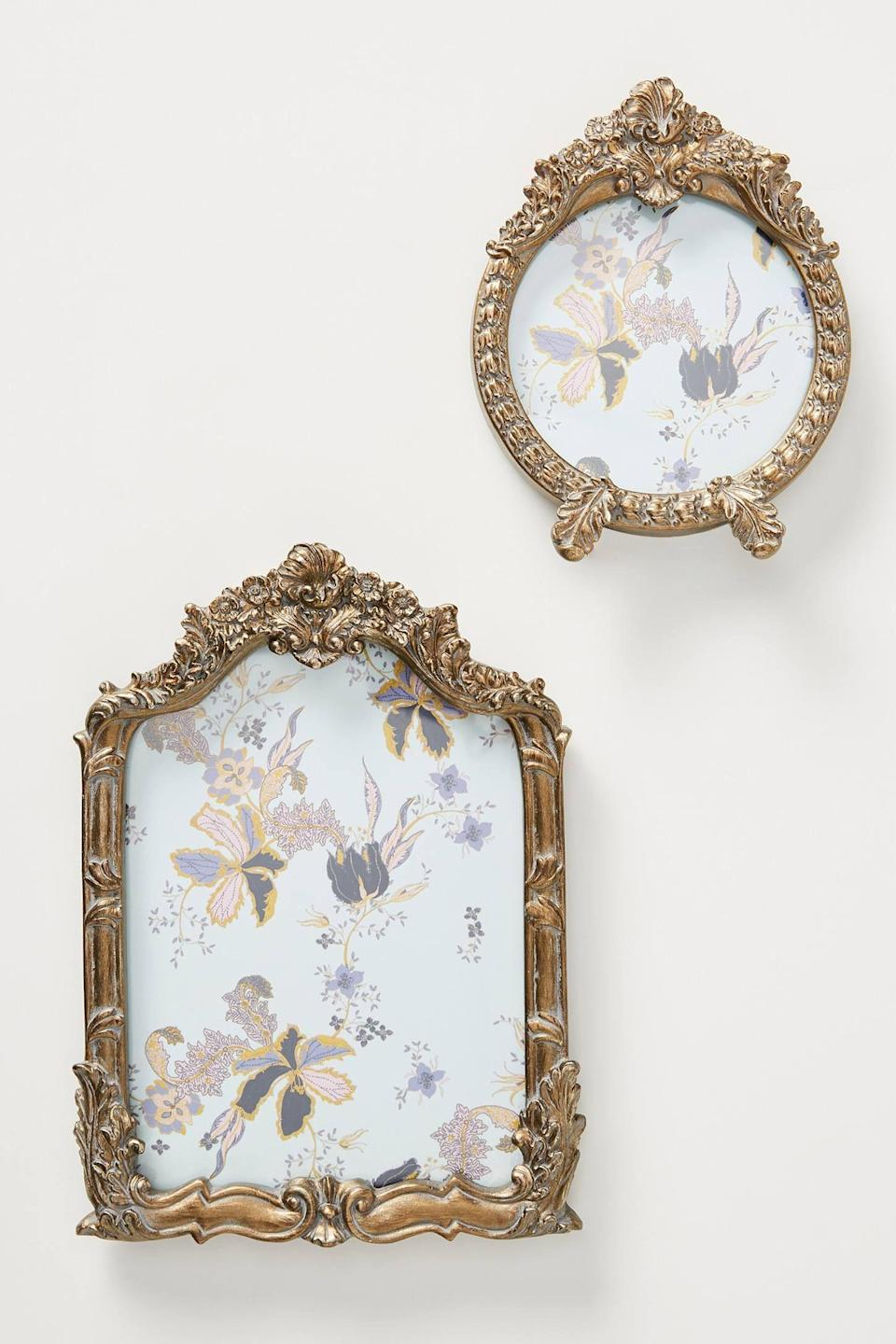 """<p><strong>Anthropologie</strong></p><p>anthropologie.com</p><p><strong>$19.50</strong></p><p><a href=""""https://go.redirectingat.com?id=74968X1596630&url=https%3A%2F%2Fwww.anthropologie.com%2Fshop%2Fvictoria-frame&sref=https%3A%2F%2Fwww.housebeautiful.com%2Fentertaining%2Fholidays-celebrations%2Fg4092%2Fvalentines-day-gifts-for-her%2F"""" rel=""""nofollow noopener"""" target=""""_blank"""" data-ylk=""""slk:BUY NOW"""" class=""""link rapid-noclick-resp"""">BUY NOW</a></p><p>Fill a gorgeous frame like these with your favorite picture of the two of you for a winning gift she'll treasure forever. </p>"""