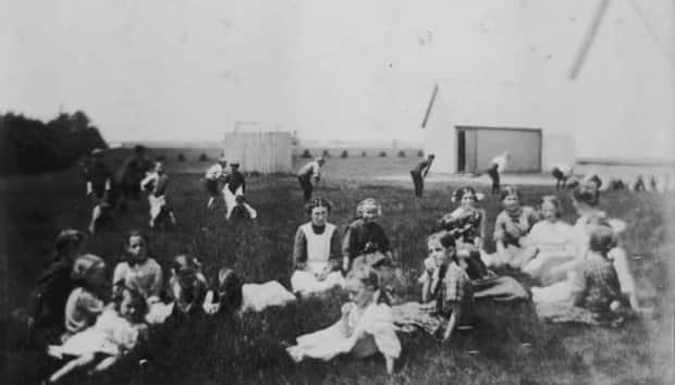 Church or community picnics were an excellent place to meet potential mates in the bygone days, especially if there was a cake or box lunch auction. This photo was taken between 1905 and 1920 in rural P.E.I., and children can be seen in the background having sack races.