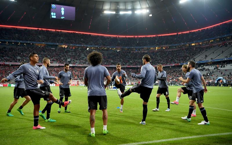 Real Madrid warm up at Bayern Munich - Credit: GETTY