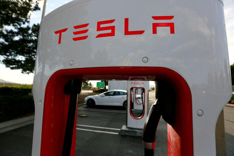 FILE PHOTO - A Tesla Model S charges at a Tesla Supercharger station in Cabazon, California