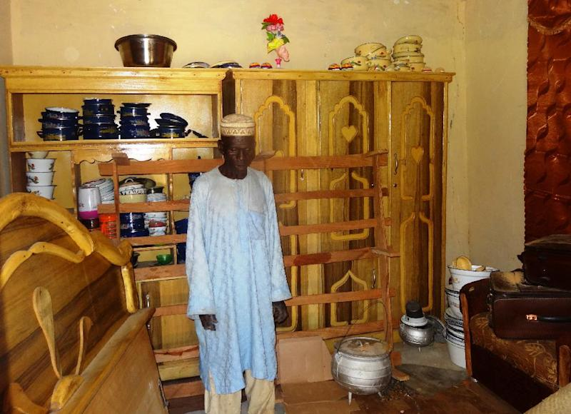 Sani Garba, 55, stands in the abandonned bedroom of his 14-year-old daughter-in-law Wasila Tasi'u on August 10, 2014 in the village of Unguwar Yansoro (AFP Photo/Aminu Abubakar)