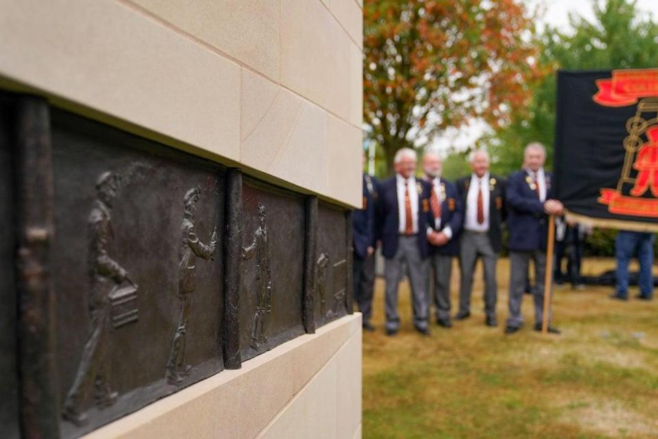 Members of the Lea Hall & Brereton Collieries Memorial Society observe the National Miners' Memorial (PA) (PA Wire)
