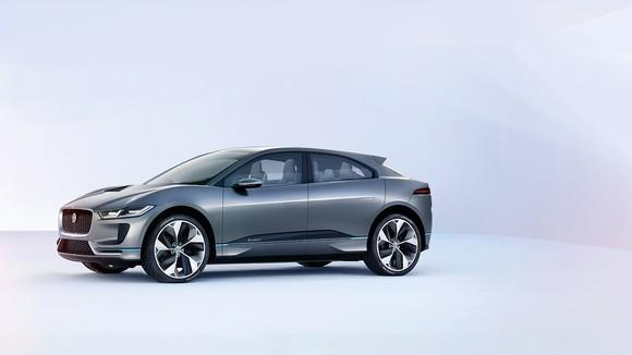 The Jaguar I-PACE in gray gunmetal, displayed in a white room.