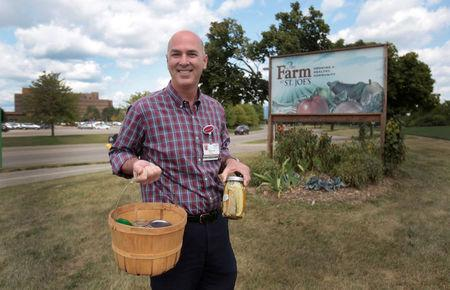 Dr. Brian Halloran, a vascular surgeon at Saint Joseph Mercy Ann Arbor, shows canned vegetables from his garden across from Saint Joseph Mercy hospital in Ypsilanti, Michigan, U.S., August 23, 2017. Picture taken August 23, 2017. REUTERS/Rebecca Cook