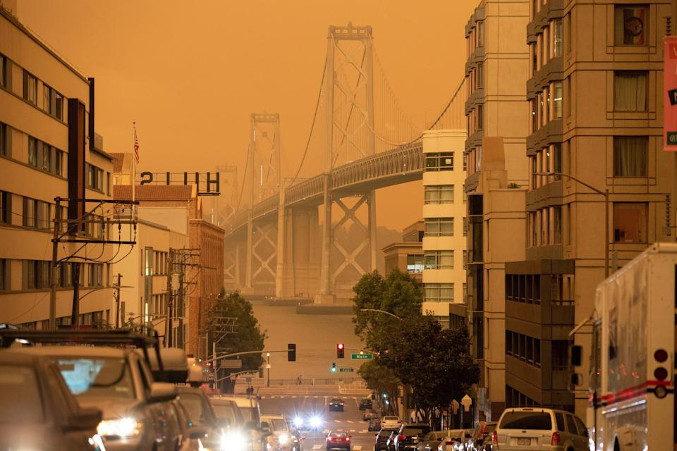 The Bay Bridge in San Francisco is seen under an orange sky darkened by the smoke from California wildfires on Sept. 9, 2020. (Photo: Stephen Lam / Reuters)
