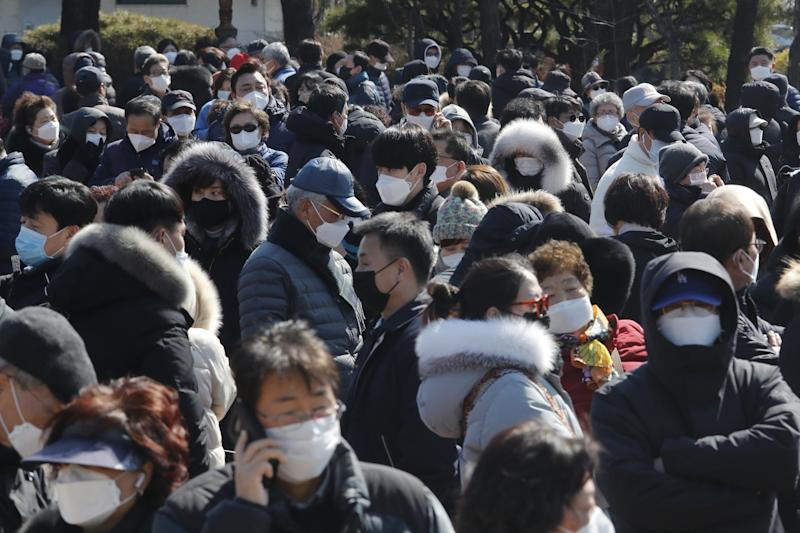A crowd of people wearing face masks in Seoul.