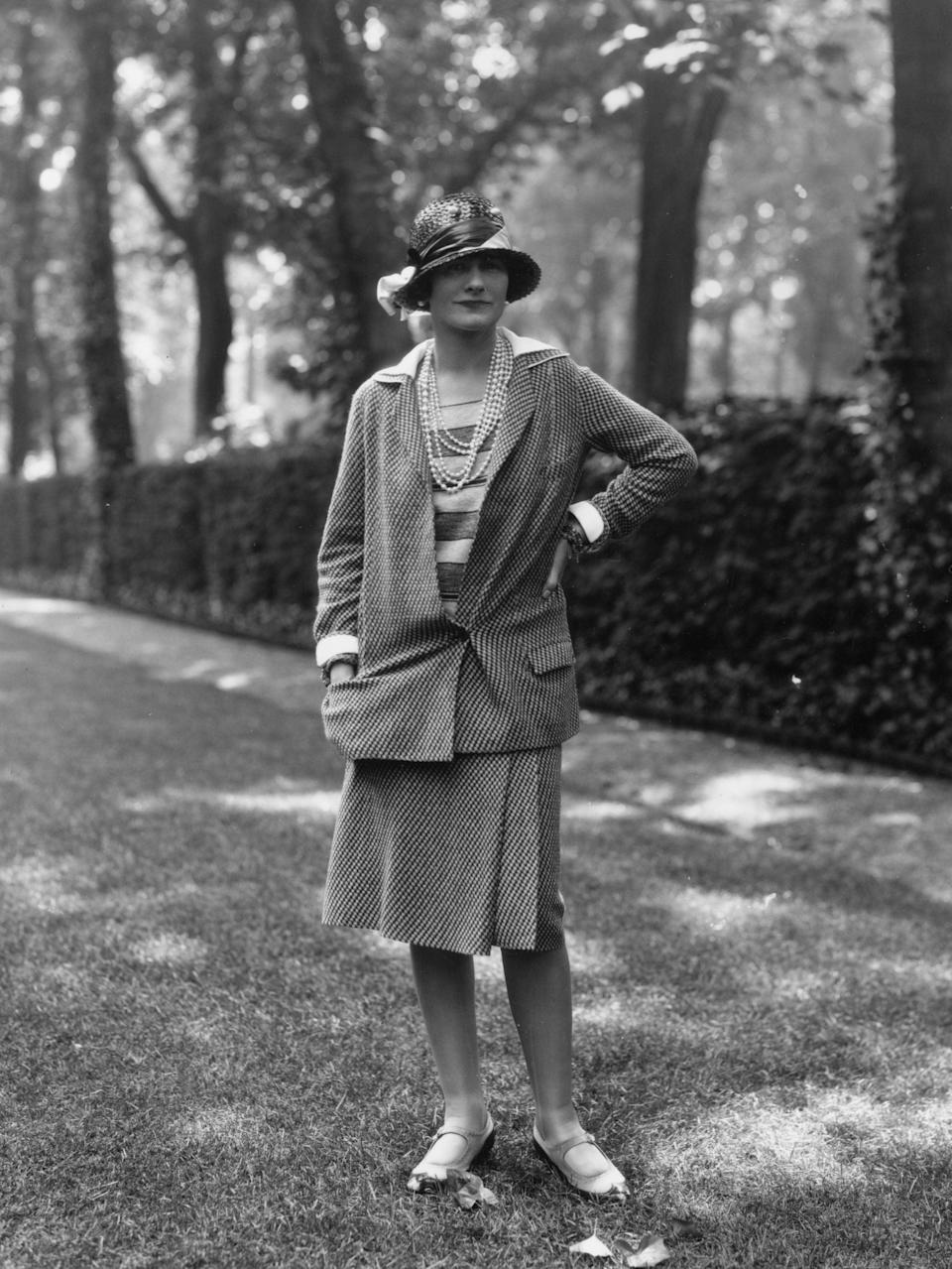 Coco Chanel modelling a Chanel suit at Fauborg, St Honore, Paris in 1929.Getty Images