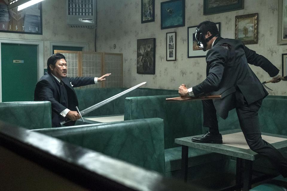Benedict Wong swordfights with a masked assailant