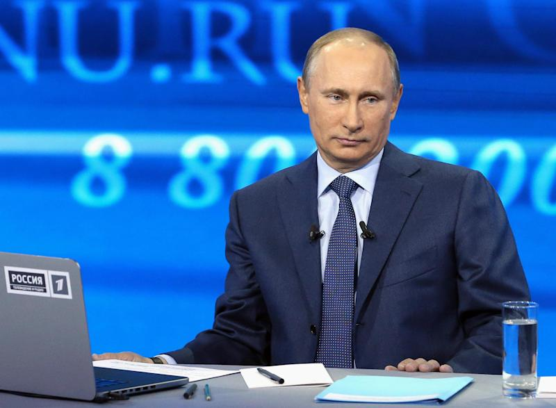 """Russian President Vladimir Putin listens to a question during an annual call-in show on Russian television """"Conversation With Vladimir Putin""""  in Moscow on Thursday, April 25, 2013. (AP Photo/RIA Novosti, Alexei Nikolsky, Presidential Press Service)"""