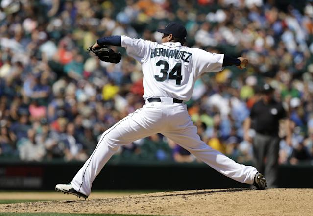 Seattle Mariners starting pitcher Felix Hernandez throws in the fifth inning of a baseball game against the Milwaukee Brewers, Sunday, Aug. 11, 2013, in Seattle. (AP Photo/Ted S. Warren)