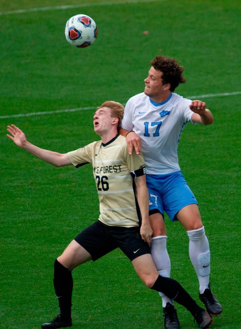 Wake Forest's Colin Thomas (26) and UNC-Chapel Hill's Cameron Fisher (17) battle for the ball during the Division I Men's Soccer Championship quarterfinals at WakeMed Soccer Park in Cary Monday, May 10, 2021.