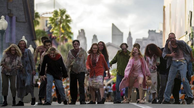 "This September 2013 image provided by Universal Orlando in Orlando, Fla., shows actors portraying zombies for the theme park's Halloween Horror Nights, which take place on select nights through Nov. 2. The zombies are inspired by AMC's show ""The Walking Dead."" One of the park's eight haunted houses is also themed on the show. (AP Photo/Universal Orlando)"