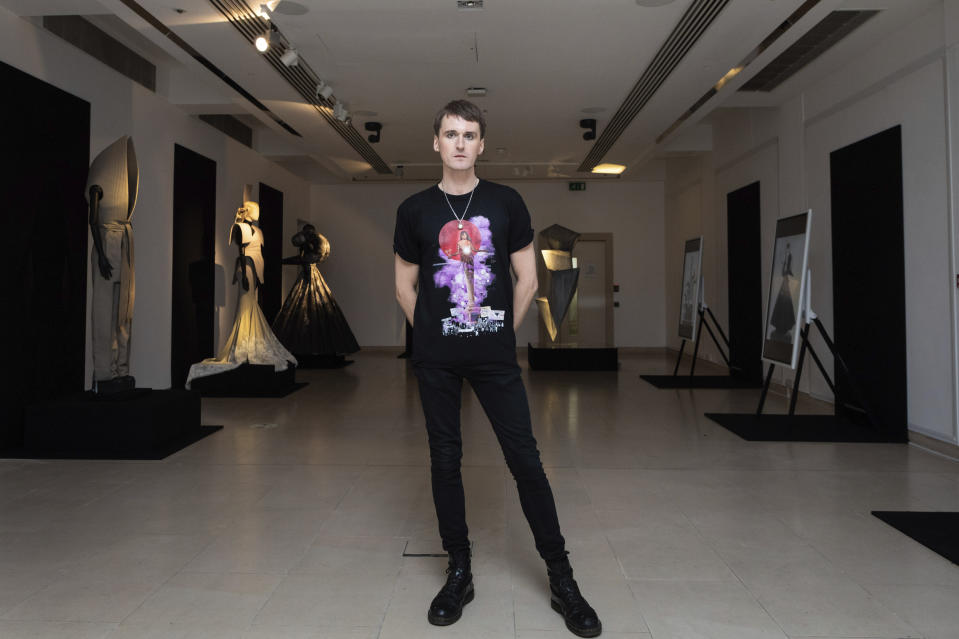 Fashion designer Gareth Pugh poses for a photograph in front of his creations, exhibited ahead of his London Fashion Week show in London, Wednesday, Sept. 16, 2020. (Photo by Vianney Le Caer/Invision/AP)