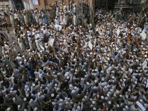 Supporters of a religious group chant slogan during a rally favouring the gunman who shot Tahir Naseem in courtroom, in Peshawar on Friday (AP Photo/Muhammad Sajjad)