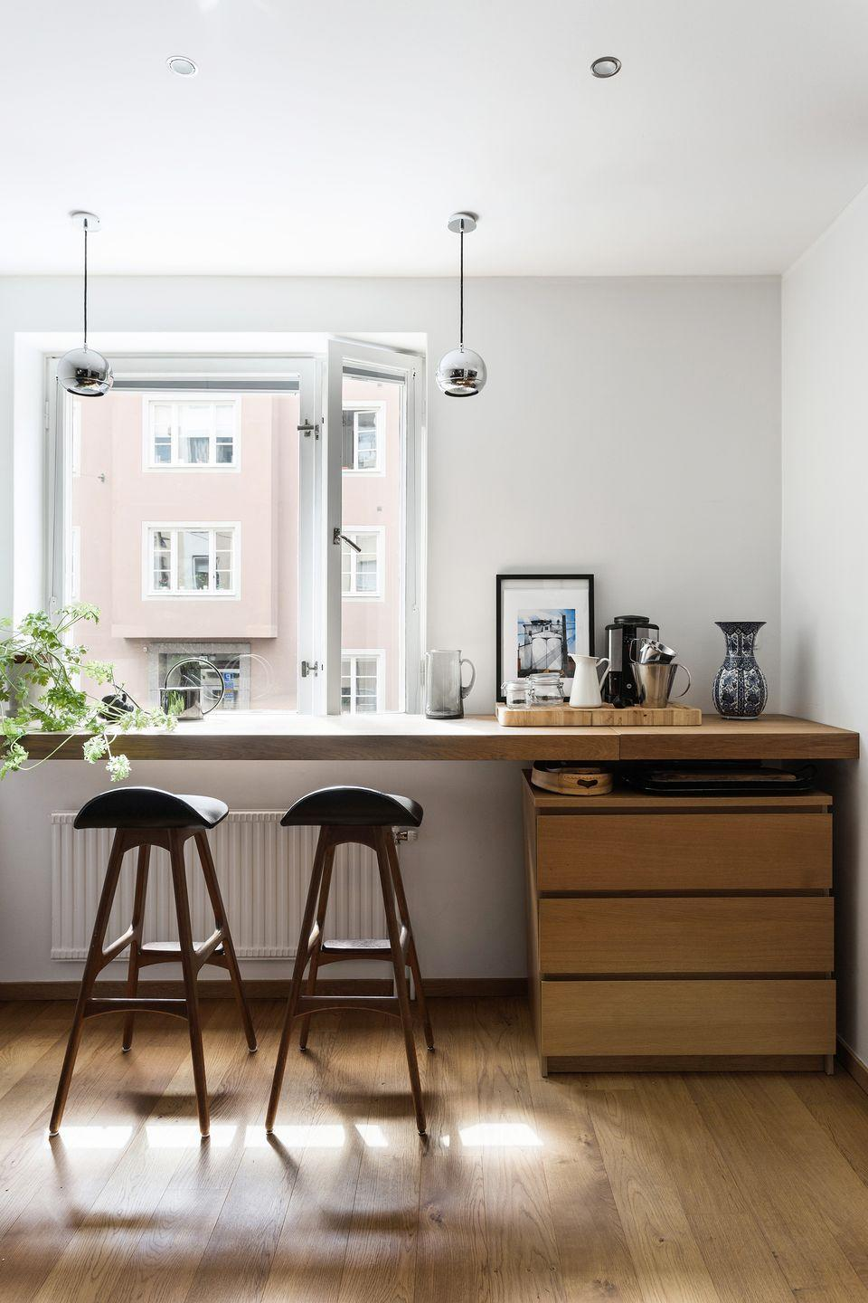 """<p>On the other hand, your could make the most of your eat-in kitchen by keeping surfaces clear and sliding up some stools to an airy window nook. This minimalist <a href=""""https://www.fantasticfrank.com/"""" rel=""""nofollow noopener"""" target=""""_blank"""" data-ylk=""""slk:Fantastic Frank"""" class=""""link rapid-noclick-resp"""">Fantastic Frank</a> space is perfect for dining and working from home. </p>"""