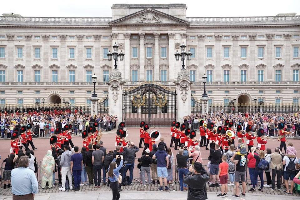 Members of the public watch the Band of The Coldstream Guards marching during the Changing the Guard ceremony (PA Wire)