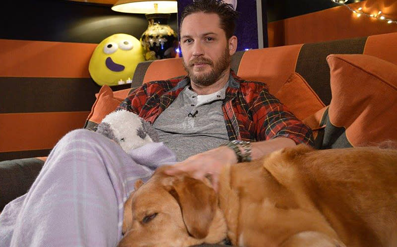 """<p>Dogs are never far from the British actor, so, of course, a pup was by his side as he celebrated the holidays in 2016. (Photo: <a rel=""""nofollow noopener"""" href=""""https://www.facebook.com/TomHardyUK/photos/a.556208251056875.135105.555896884421345/1395242927153399/?type=3&theater"""" target=""""_blank"""" data-ylk=""""slk:Tom Hardy via Facebook"""" class=""""link rapid-noclick-resp"""">Tom Hardy via Facebook</a>) </p>"""
