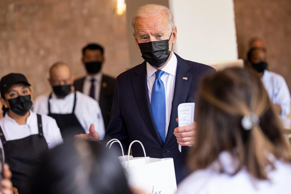 <p>Joe Biden visits Taqueria Las Gemelas in Washington DC on 5 May, among one of the first restaurants to receive funds from a $28.6bn relief programme.</p> (EPA)