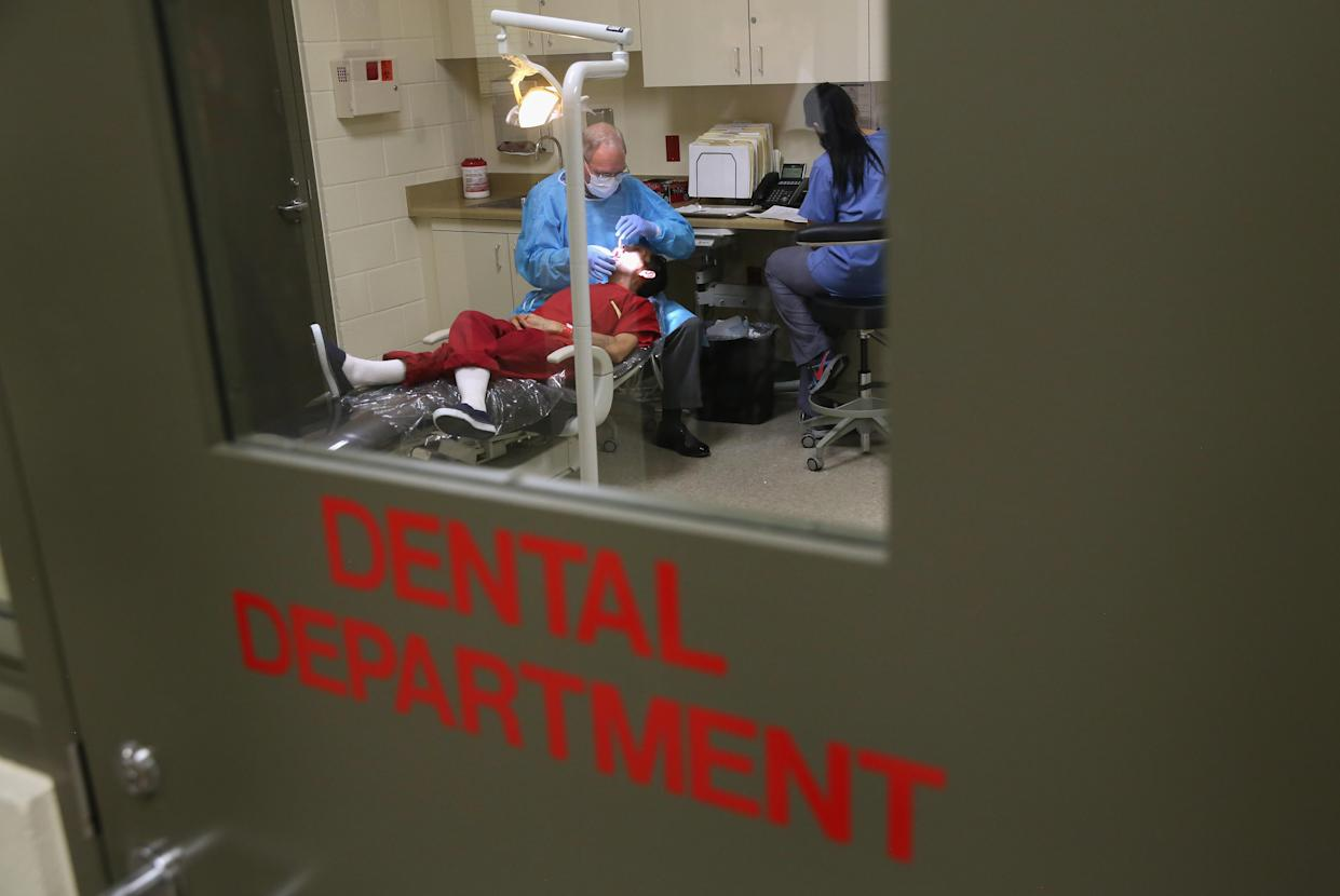 An immigrant receives dental care at the Adelanto Detention Facility in 2013 in Adelanto, Calif. (Photo: John Moore/Getty Images)