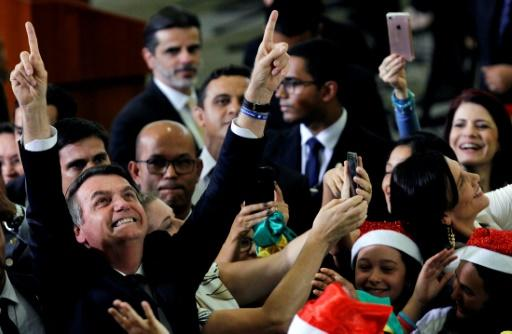 The health of Brazil's President Jair Bolsonaro, pictured at a Christmas event in Brasilia on December 19, 2019, has been a subject of concern since he took office