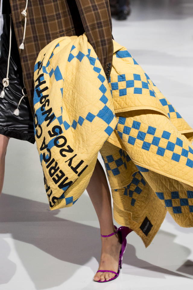 <p><i>Yellow and blue quilted blanket with Calvin Klein lettering from the SS18 Calvin Klein collection. (Photo: ImaxTree) </i></p>