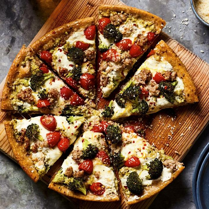 <p>Using a cast-iron skillet for this healthy pizza recipe gives you deep-dish pizza results with extra-crispy sides, but you can make it free-form too. Stretch the dough into a 12-inch oval and place on a large baking sheet coated with cooking spray. Top and bake at 450 degrees F until the cheese is melted and the crust is crisp, about 20 minutes.</p>