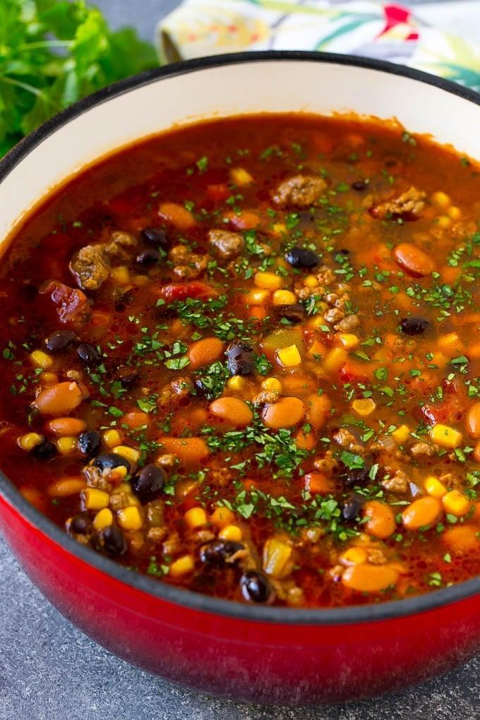 """<p><a href=""""https://www.popsugar.com/fitness/Low-Carb-Soup-Recipes-45482982"""" class=""""link rapid-noclick-resp"""" rel=""""nofollow noopener"""" target=""""_blank"""" data-ylk=""""slk:Soup recipes"""">Soup recipes</a> can be time-consuming, but not this one-pot taco soup. Ditch the tortilla strip topping for sour cream, avocado, or shredded cheese.</p> <p><strong>Get the recipe:</strong> <a href=""""https://www.dinneratthezoo.com/taco-soup-recipe/"""" class=""""link rapid-noclick-resp"""" rel=""""nofollow noopener"""" target=""""_blank"""" data-ylk=""""slk:taco soup"""">taco soup</a></p>"""