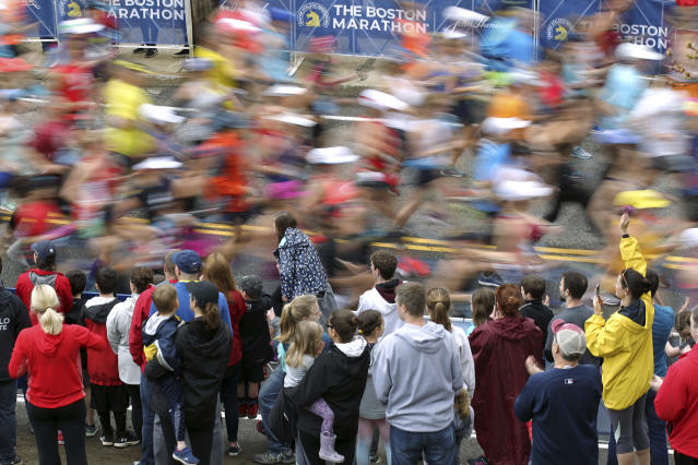 Fans cheer on the third wave of runners at the start of the 123rd Boston Marathon on Monday, April 15, 2019, in Hopkinton, Mass. (AP Photo/Stew Milne)
