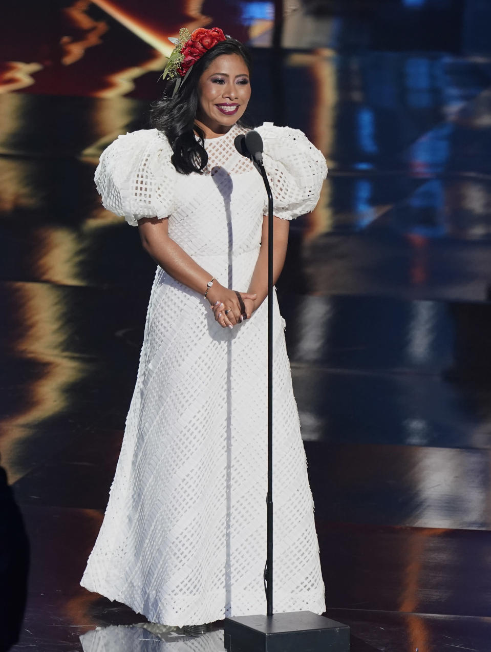 Host Yalitza Aparicio speaks at the 21st Latin Grammy Awards, airing on Thursday, Nov. 19, 2020, at American Airlines Arena in Miami. (AP Photo/Marta Lavandier)