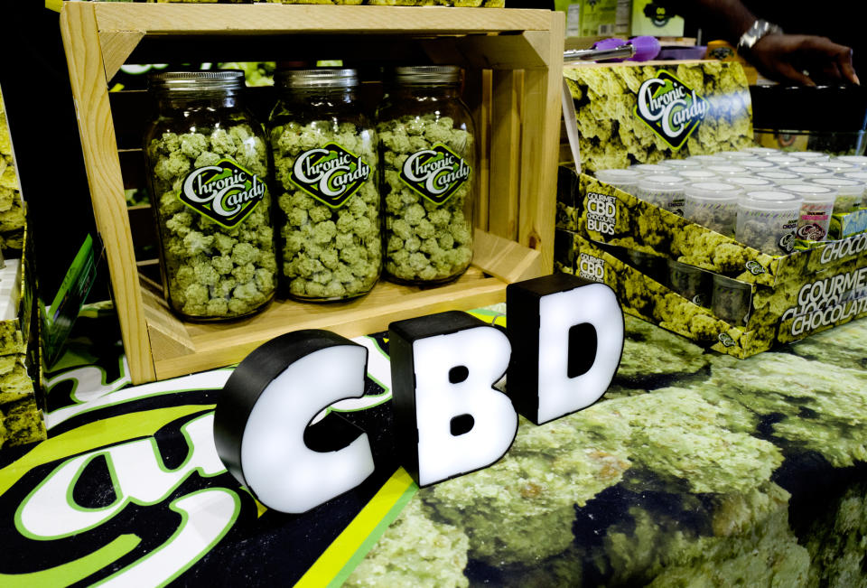 FILE- In this Aug. 31, 2018, file photo CBD buds of chocolate by Chronic Candy are displayed at the Big Industry Show at the Los Angeles Convention Center. From skin-care lotions to bottled water, cannabis companies are rolling out a growing array of consumer products infused with a chemical found in marijuana called cannabidiol, or CBD. (AP Photo/Richard Vogel, File)