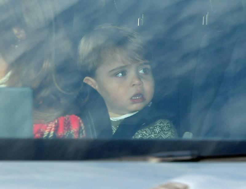 Prince Louis in the car on his way to Buckingham Palace.