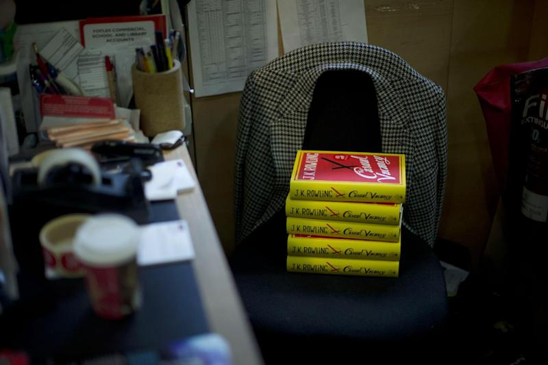 """Copies of the """"The Casual Vacancy"""" by author J.K. Rowling rest on a chair behind the sales counter to go on the shelves at a book store in London, Thursday, Sept. 27, 2012. British bookshops are opening their doors early as Harry Potter author J.K. Rowling launches her long anticipated first book for adults. Publishers have tried to keep details of the book under wraps ahead of its launch Thursday, but """"The Casual Vacancy"""" has gotten early buzz about references to sex and drugs that might be a tad mature for the youngest """"Potter"""" fans. (AP Photo/Matt Dunham)"""