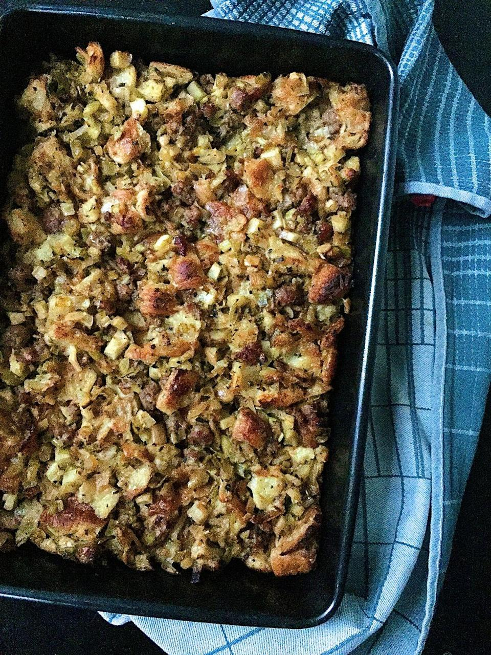 """<p>Torn fresh croissants make this stuffing extra rich and amazingly buttery.</p><p>Get the recipe from <a href=""""https://www.delish.com/holiday-recipes/thanksgiving/recipes/a44602/croissant-stuffing-sausage-apples-recipe/"""" rel=""""nofollow noopener"""" target=""""_blank"""" data-ylk=""""slk:Delish"""" class=""""link rapid-noclick-resp"""">Delish</a>.</p>"""