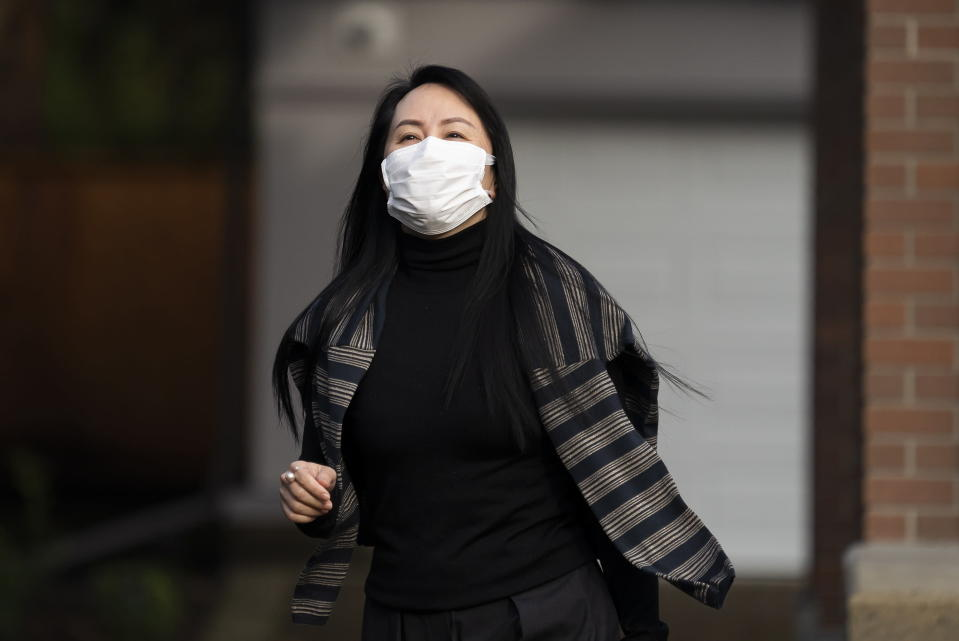 Meng Wanzhou, the chief financial officer of Huawei, leaves her home in Vancouver, British Columbia, to attend a court hearing, Monday, March 1, 2021. (Jonathan Hayward/The Canadian Press via AP)