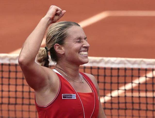 Slovakia's Dominika Cibulkova reacts afte winning over Belarus Victoria Azarenka during their Women's Singles 4th Round tennis match of the French Open tennis tournament at the Roland Garros stadium, on June 3, 2012 in Paris. AFP PHOTO / JACQUES DEMARTHONJACQUES DEMARTHON/AFP/GettyImages