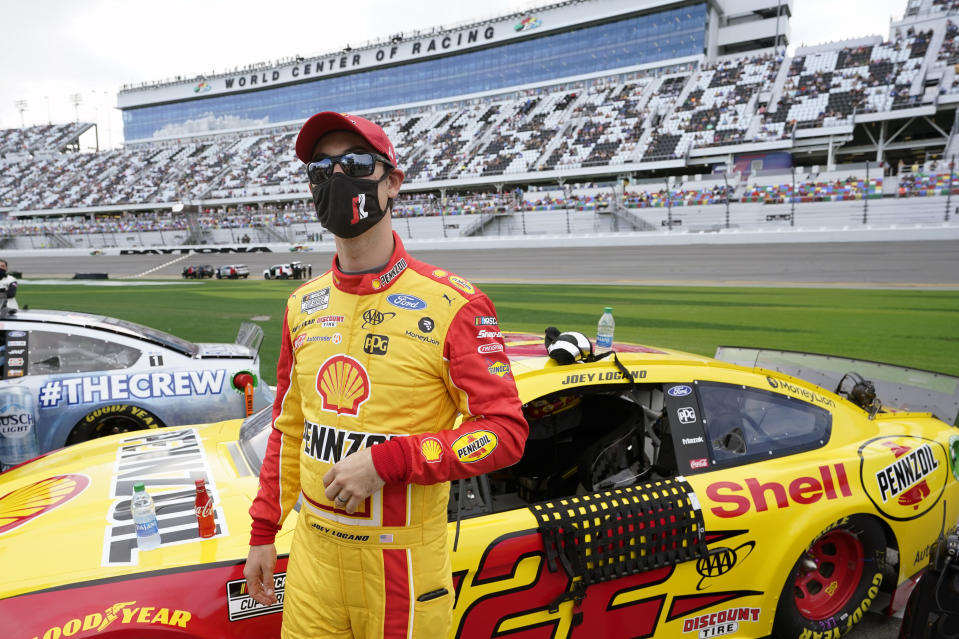 Joey Logano stands by his car on pit road before the start of the NASCAR Daytona 500 auto race at Daytona International Speedway, Sunday, Feb. 14, 2021, in Daytona Beach, Fla. (AP Photo/John Raoux)