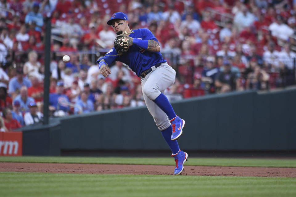 Chicago Cubs shortstop Javier Baez throws out St. Louis Cardinals' Yadier Molina during the second inning of a baseball game Wednesday, July 21, 2021, in St. Louis. (AP Photo/Joe Puetz)