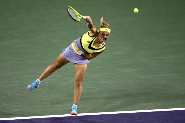 Svetlana Kuznetsova of Russia serves to Karolina Pliskova of Czech Republic during their BNP Paribas Open semi-final match, at the Indian Wells Tennis Garden in California, on March 17, 2017
