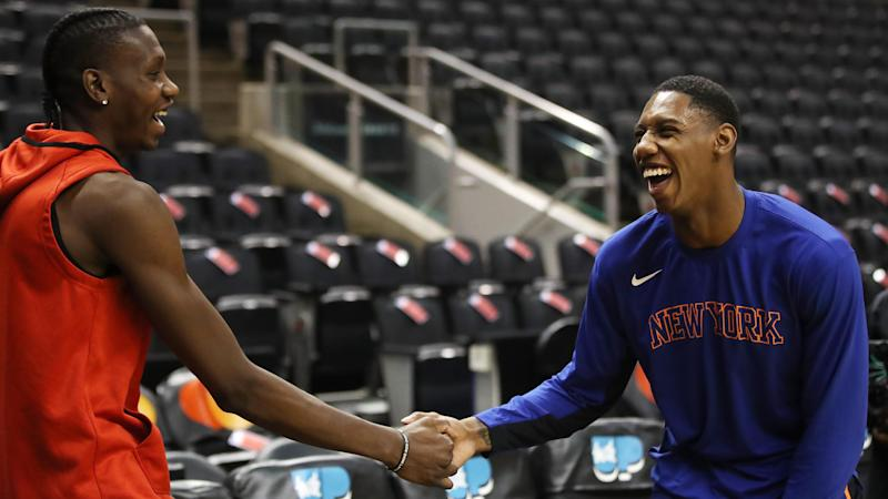 TORONTO, ON- NOVEMBER 27 - Canadians Toronto Raptors forward Chris Boucher (25) and New York Knicks forward RJ Barrett greet each other as they warm up before the game as the Toronto Raptors play the New York Knicks at Scotiabank Arena in Toronto. November 27, 2019. (Steve Russell/Toronto Star via Getty Images)