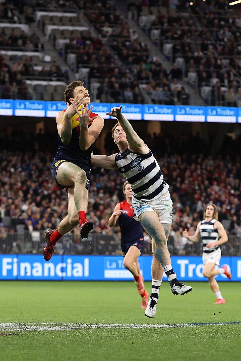 Jake Lever marks the ball against Gary Rohan of the Cats during the AFL First Preliminary Final match.