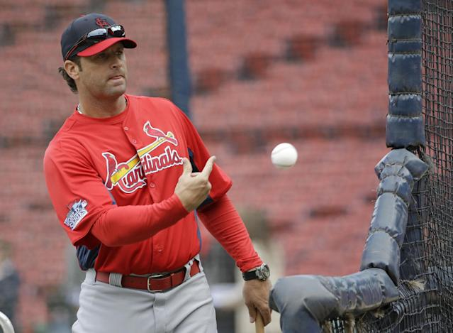 St. Louis Cardinals manager Mike Matheny tosses a ball during batting practice for Game 1 of baseball's World Series against the Boston Red Sox Tuesday, Oct. 22, 2013, in Boston. (AP Photo/David J. Phillip)
