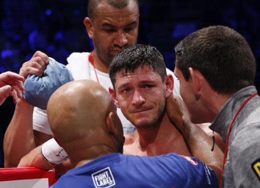 British champion Jamie McDonnell, center, reacts after his first round technical knockout loss to his Japanese challenger Naoya Inoue during their WBA World bantamweight title match in Tokyo Friday, May 25, 2018.(AP Photo/Shuji Kajiyama)
