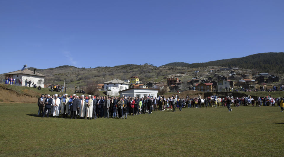 Imams lead the procession during mass circumcision ceremony in the village of Ribnovo, Bulgaria, Sunday, April 11, 2021. Despite the dangers associated with COVID-19 and government calls to avoid large gatherings, Hundreds of people flocked to the tiny village of Ribnovo in southwestern Bulgaria for a four-day festival of feasting, music and the ritual of circumcision which is considered by Muslims a religious duty and essential part of a man's identity. (AP Photo/Jordan Simeonov)