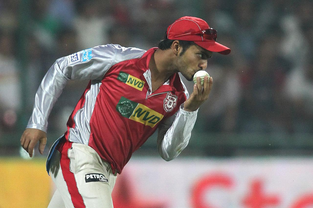 Mandeep Singh of the Kings XI Punjab kisses the ball after taking the catch to get Kedar Jadhav of Delhi Daredevils wicket during match 32 of the Pepsi Indian Premier League between The Delhi Daredevils and the Kings XI Punjab held at the Feroz Shah Kotla Stadium, Delhi on the 23rd April 2013..Photo by Shaun Roy-IPL-SPORTZPICS  ..Use of this image is subject to the terms and conditions as outlined by the BCCI. These terms can be found by following this link:..https://ec.yimg.com/ec?url=http%3a%2f%2fwww.sportzpics.co.za%2fimage%2fI0000SoRagM2cIEc&t=1498312079&sig=QcnT44xkJ7jAvROPJ1Q58g--~C