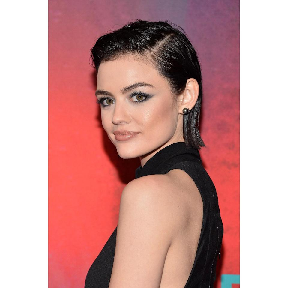 Lucy Hale's hair falls just above her shoulders, but a knife-sharp part just above the highest point of her eyebrow opens up her face. Rather than pressing her strands all the way down, her stylist gave her a little height and texture all over. Pair this style with an edgier, non-traditional wedding look like a suit or a jumpsuit.