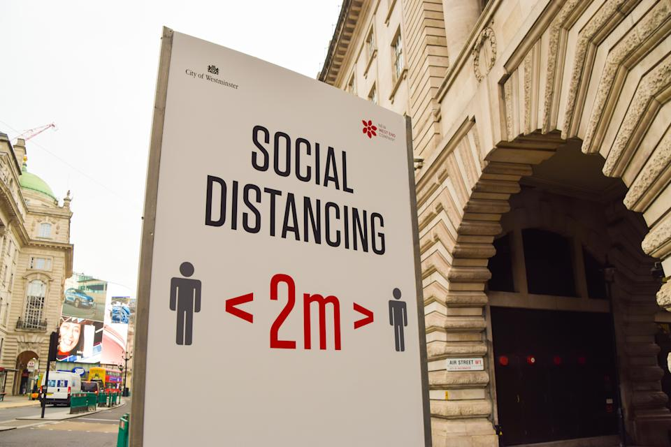 A view of a Social Distancing sign on Regent Street. England is set to enforce a new tier system once the lockdown ends on 2 December. (Photo by Vuk Valcic / SOPA Images/Sipa USA)