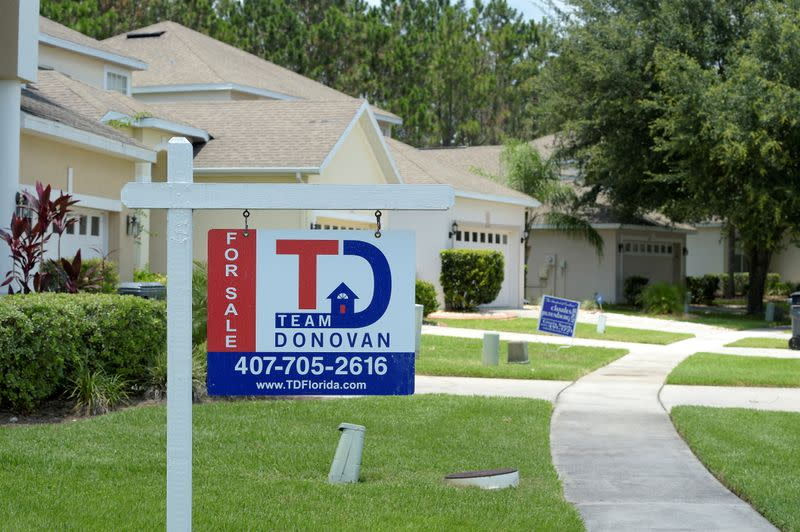FILE PHOTO: For Sale signs stand in front of houses in a neighborhood where many British people have purchased homes