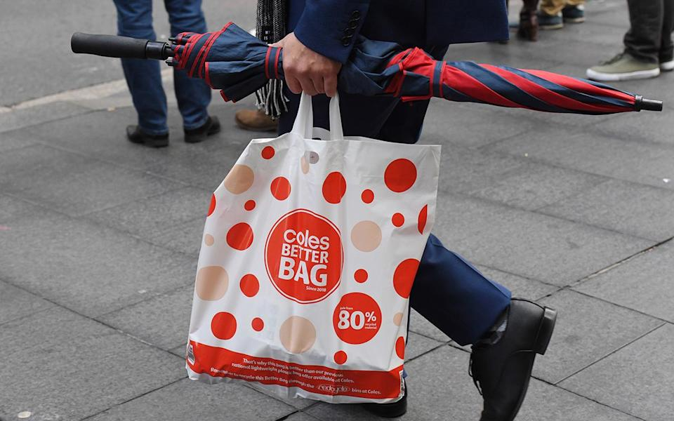 A shopper is seen carrying a reusable plastic bag at a Coles Sydney CBD store shortly after the change in their policy. Image: AAP